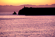 PORTUGAL, ALGARVE, SOUTH COAST Cape St. Vincent Lighthouse; southwestern most point in Europe at sunset