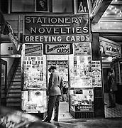 Man looking into novelty shop storefront, San Francisco, 1947