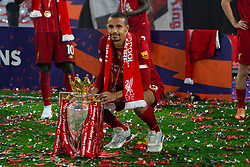 LIVERPOOL, ENGLAND - Wednesday, July 22, 2020: Liverpool's Joel Matip celebrates with the Premier League trophy as the Reds are crowned Champions after the FA Premier League match between Liverpool FC and Chelsea FC at Anfield. The game was played behind closed doors due to the UK government's social distancing laws during the Coronavirus COVID-19 Pandemic. Liverpool won 5-3. (Pic by David Rawcliffe/Propaganda)