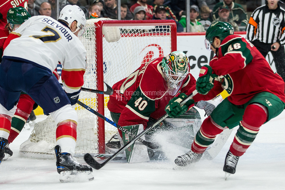 Dec 13, 2016; Saint Paul, MN, USA; Minnesota Wild goalie Devan Dubnyk (40) makes a save on Florida Panthers forward Colton Sceviour (7) during the second period at Xcel Energy Center. Mandatory Credit: Brace Hemmelgarn-USA TODAY Sports