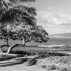 Wailea Makena Maui Hawaii black and white panorama photo with a palm tree, outrigger canoe and Kaho'olawe Island along the Pacific Ocean. Panoramic photo ratio is 1:3. Copyright ⓒ 2019 Paul Velgos with All Rights Reserved.