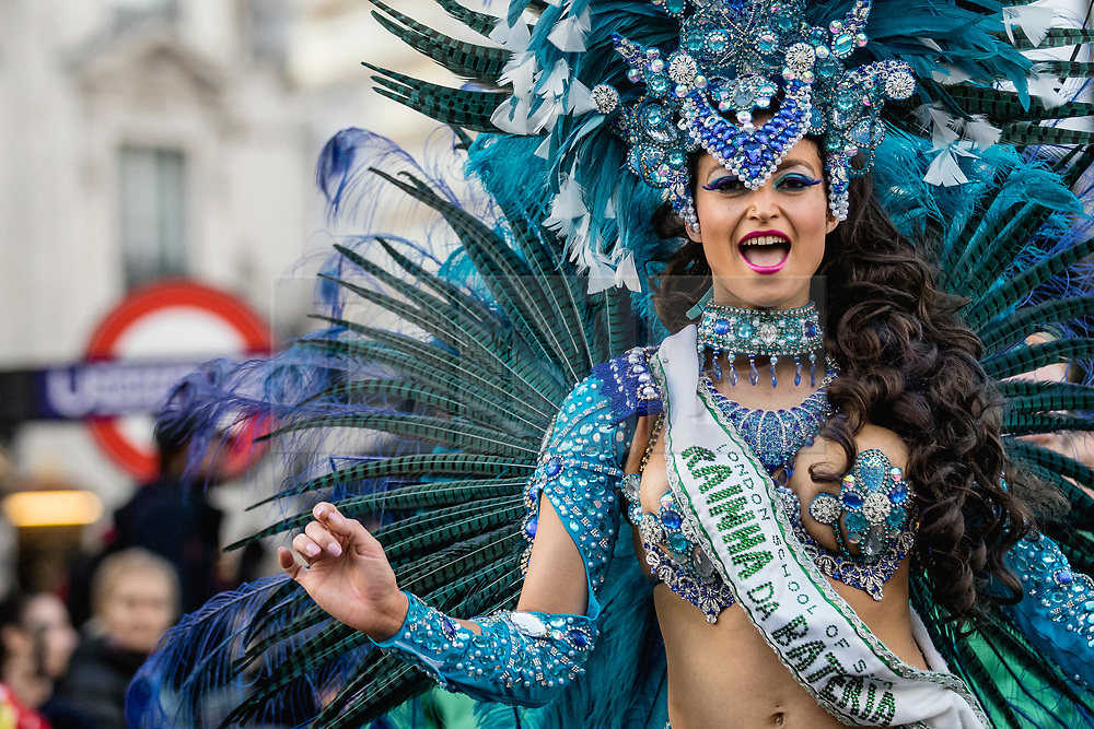 © Licensed to London News Pictures. 01/01/2019. London, UK. Dancers from the London School of Samba perform during the London New Year's Day Parade. More than 8,000 performers from 26 countries are taking part in the parade. Photo credit: Rob Pinney/LNP
