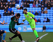 Josh Lillis heads clear during the Sky Bet League 1 match between Coventry City and Rochdale at the Ricoh Arena, Coventry, England on 5 March 2016. Photo by Daniel Youngs.