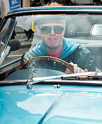 © Licensed to London News Pictures. 17/06/2015. London, UK. Presenter CHRIS EVANS leaving the BBC radio studio in London driving a classic Austin Martin covetable DB5 car, a day after it was announced that he will be the new presenter of Top Gear. Photo credit: Ben Cawthra/LNP