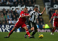 Photo: Andrew Unwin.<br />Newcastle United v Middlesbrough. The Barclays Premiership. 02/01/2006.<br />Middlesbrough's Lee Cattermole (L) gets hold of Newcastle's Lee Clark (R).