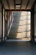 a long stairway at the end of a corridor at the Todai-ji Nigatsu-do temple in Nara Japan