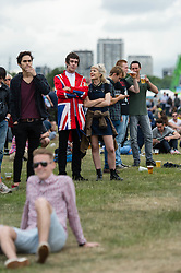 © Licensed to London News Pictures. 05/07/2014. London, UK.   Fans of The Libertines wearing the bands' look - union jack and army drummer clothing  - in Hyde Park where The Libertines are to perform first UK reunion gig later today.   They released their final self titled album in 2004 & the band split after their final show in Decemer 2014.   Photo credit : Richard Isaac/LNP