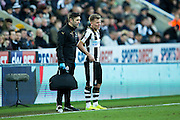 Newcastle United midfielder Matt Ritchie (#11) waits on the sidelines following an injury during the EFL Sky Bet Championship match between Newcastle United and Derby County at St. James's Park, Newcastle, England on 4 February 2017. Photo by Craig Doyle.