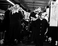 A Hasidic Jewish family keep themselves entertained while waiting for the A Train at Broadway Junction in Brooklyn, New York, USA.