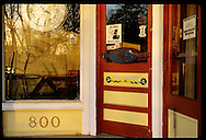 Detail of door, signs and clock at the entrance to the DDD Deli in Kirkwood. Missouri