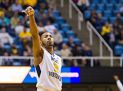 Nov 28, 2016; Morgantown, WV, USA; West Virginia Mountaineers guard Jevon Carter (2) shoots a three pointer during the first half against the Manhattan Jaspers at WVU Coliseum. Mandatory Credit: Ben Queen-USA TODAY Sports