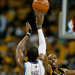 25 April 2009: New Orleans Hornets guard Chris Paul (3) shoots over Denver Nuggets guard Chauncey Billups (7) during a 95-93 win by the New Orleans Hornets over the Denver Nuggets in game three of the NBA Western Conference quarter-finals playoff at the New Orleans Arena in New Orleans, Louisiana.