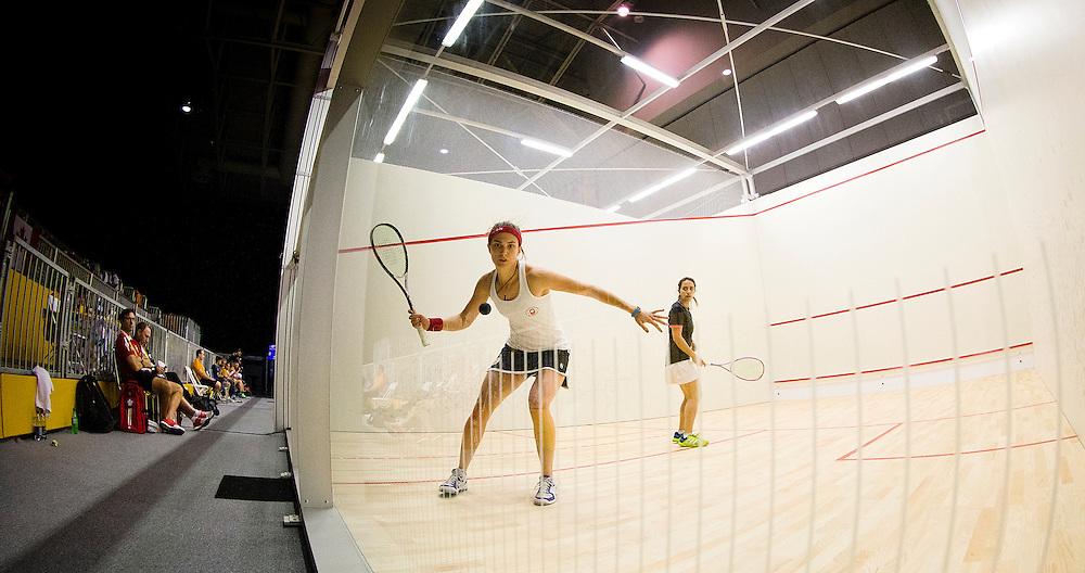 Canadian Squash player Sam Cornett hits a return.