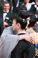 Jun Murakami and Miyuki Matsuda at the Still The Water gala screening red carpet at the 67th Cannes Film Festival France. Tuesday 20th May 2014 in Cannes Film Festival, France.