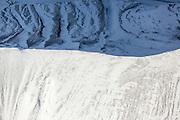 A mountain ridge divides snowfall into light and shade near the Eyjafjallajökull volcano in Iceland
