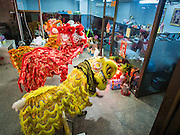 "19 FEBRUARY 2015 - BANGKOK, THAILAND: Chinese lion dancers perform for Chinese New Year in a jewelry business on Yaowarat Road in Bangkok. 2015 is the Year of Goat in the Chinese zodiac. The Goat is the eighth sign in Chinese astrology and ""8"" is considered to be a lucky number. It symbolizes wisdom, fortune and prosperity. Ethnic Chinese make up nearly 15% of the Thai population. Chinese New Year (also called Tet or Lunar New Year) is widely celebrated in Thailand, especially in urban areas that have large Chinese populations.    PHOTO BY JACK KURTZ"