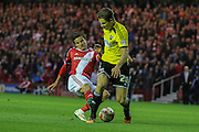 Toumani Diagouraga tackles Jelle Vossen during the Sky Bet Championship Play Off Second Leg match between Middlesbrough and Brentford at the Riverside Stadium, Middlesbrough, England on 15 May 2015. Photo by Simon Davies.