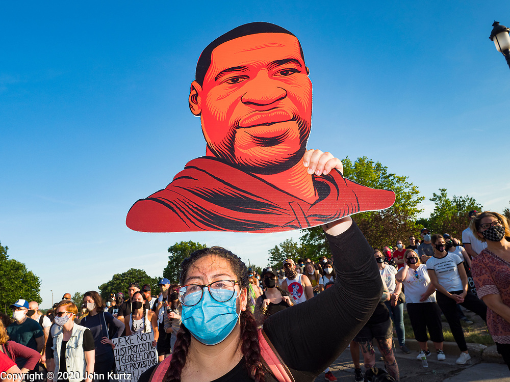 01 JUNE 2020 - DES MOINES, IOWA: A woman holds a cutout of George Floyd during a Black Lives Matter protest in front of the Iowa State Capitol Monday. About 1,000 people gathered in front of the Iowa State Capitol in Des Moines Monday evening for a rally calling for racial justice. The rally was one week after George Floyd, an unarmed black man, was killed by a Minneapolis police officer who knelt on Floyd's back for more than eight minutes. There were protests  in Des Moines all weekend against Floyd's killing. There was some violence and some people have been arrested but the protests in Des Moines haven't been as serious as protests in other cities.          PHOTO BY JACK KURTZ