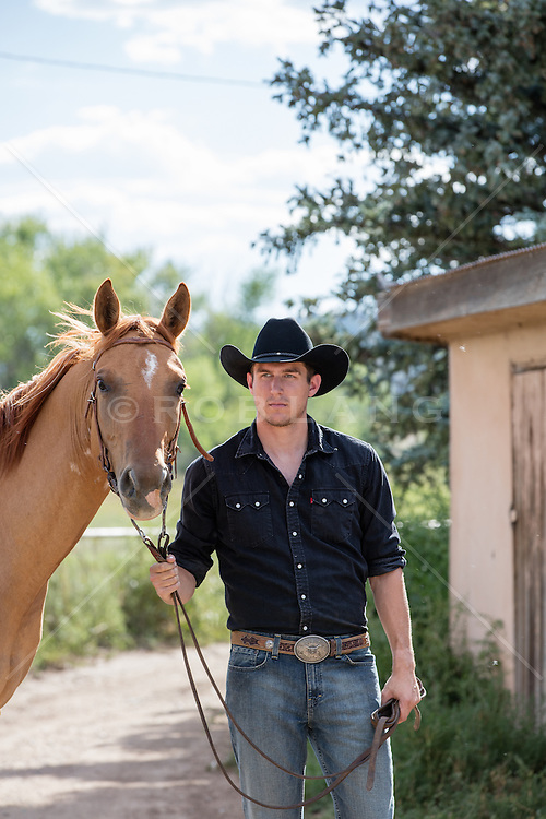 cowboy with a horse on a ranch in New Mexico