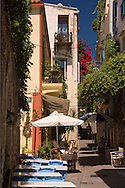 Traditional Greek tables and chairs at Tamam Taverna on a backstreet in Hania,<br /> Crete, Greece