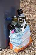Empty glass wine bottles out for collection