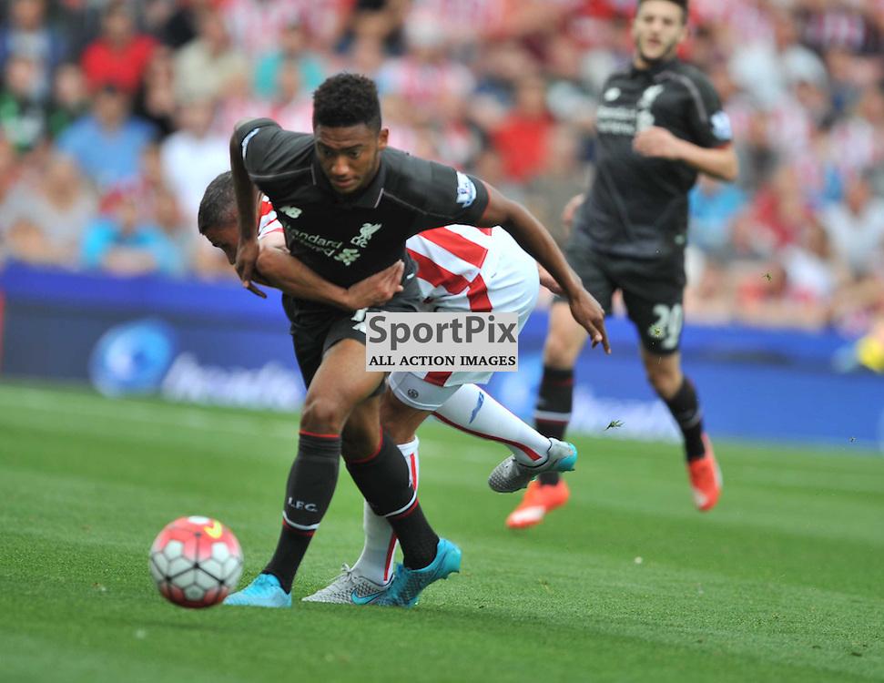 Liverpools Joe Gomez pushes sTOKES jonathan Walters Stoke City v Liverpool Premiership Brittania Stadium, Sunday 9th August 2015