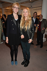 Left to right, sisters VIRGINIA CAYZER and ANGELICA CAYZER at a reception to celebrate the publication of Hockney - A Pilgrim's Progress by Christopher Simon Sykes held at Sotheby's, New Bond Street, London on 30th September 2014.
