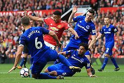 17th September 2017 - Premier League - Manchester United v Everton - Jesse Lingard of Man Utd shoots under pressure from Everton players Phil Jagielka (L), Ashley Williams (C) and Michael Keane - Photo: Simon Stacpoole / Offside.