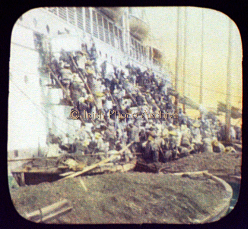 Workers coaling a ship: Nagasaki, Japan, 1895. Hand-coloured lantern slide. Transport Ship Steam