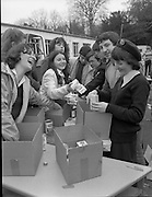 1982<br /> 27.02.1982<br /> 02.27.1982<br /> 27 Feb 1982<br /> Red Cross Food Packs for Poland at Ratra House, Phoenix Park, Dublin.  <br /> Volunteers share a laugh as they pack the food into cartons