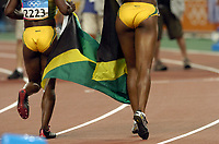 25/08/04 - ATHENS  - GREECE -  - Woman 200Mts. FINAL   -  Olympic Stadium - <br />Runner N*2223 CAMPBELL VERONICA and N*3259 FELIX ALLYSON from Jamaica JAM) celebrating the gold and silver medal n  the 200Mts. <br />© Gabriel Piko / Argenpress.com / Piko-Press