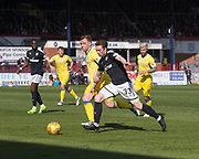 21st April 2018, Dens Park, Dundee, Scotland; Scottish Premier League football, Dundee versus St Johnstone; Craig Wighton of Dundee goes past Liam Craig of St Johnstone