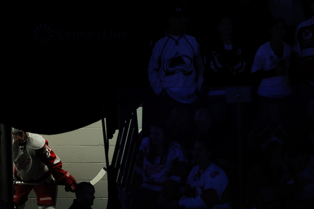 Drew Miller #20 of the Detroit Red Wings waits in the locker room before taking the ice against the Colorado Avalanche at Pepsi Center on October 8, 2011 in Denver, Colorado.