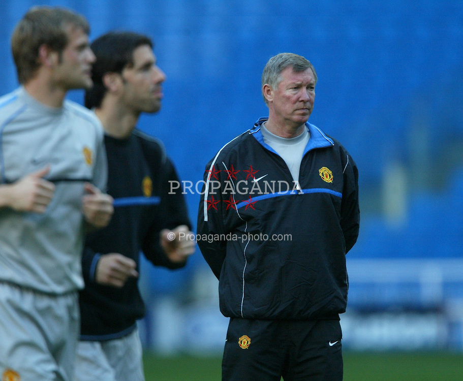 MADRID, SPAIN - Monday, April 7, 2003: Manchester United's manager Alex Ferguson watches his side training at the Estadio Santiago Bernabeu ahead of his side's Champions League Quarter Final 1st Leg match with Real Madrid. (Pic by David Rawcliffe/Propaganda)