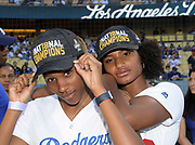 Jun 13, 2018; Los Angeles, CA, USA; Kyra Constantine (left) and Anna Cockrell pose before a MLB game between the Texas Rangers and the Los Angeles Dodgers at Dodger Stadium. Constantine and Cockrell ran the first and second legs of the Southern California Trojans women's 4 x 400m relay team that won the NCAA title to clinch the national team championship.