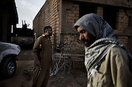 LIBYAN ARAB JAMAHIRIYA, Gualish : A Libyan rebel fighter on the front line by near the southwest desert hamlet of Gualish as rebels repel an attack from forces loyal to Moamer Kadhafi aimed at capturing the city on July 24, 2011.ALESSIO ROMENZI