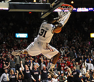 "Mississippi's Murphy Holloway (31) dunks vs. Mississippi State at the C.M. ""Tad"" Smith Coliseum in Oxford, Miss. on Wednesday, January 18, 2012. Mississippi won 75-68. (AP Photo/Oxford Eagle, Bruce Newman)."