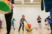 Mitchell Robinson, 6, of Canandaigua, plays with a beach ball at the fourth annual Korean Lunar New Year celebration at Brooks Hill School in Fairport on Saturday, February 7, 2015.