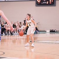 3rd year guard Avery Pearce (4) of the Regina Cougars during the Women's Basketball home game on November 24 at Centre for Kinesiology, Health and Sport. Credit: Arthur Ward/Arthur Images