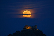 31/03/2018. A full moon rises over Almodovar del Rio Castle on March 31, 2018 in Almodovar del Rio, Cordoba province, Spain. The castle of Moorish origins was made in the VII century. It was used to film Game of Thrones episodes.  (Photo by Pablo Blazquez Dominguez)