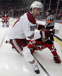 Mar 12, 2009; Newark, NJ, USA; Phoenix Coyotes right wing Shane Doan (19) and New Jersey Devils defenseman Johnny Oduya (29) battle for the puck during the first period at the Prudential Center.