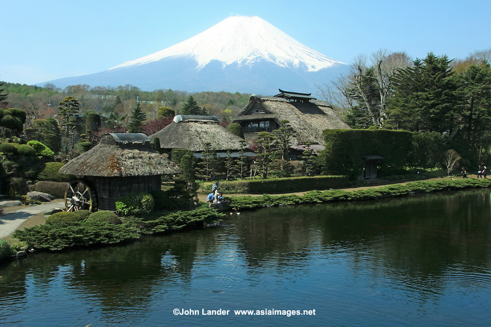 Japanese Thatched Cottage at Mt Fuji - Oshino Village - Mount Fuji or Fuji-san as it is called in Japan (not Fujiyama)  is the highest mountain in Japan at 3,776 meters or 12,388 feet in altitude.  Mt Fuji is an active volcano that last erupted in 1707; Fuji straddles Shizuoka and Yamanashi prefectures just west of Tokyo, from where it can be seen on a clear day. Mount Fuji's symmetrical cone is a well known symbol of Japan and is frequently visible in art and photographs.  Although Mount Fuji has not erupted in over 300 years its still not considered to be extinct.
