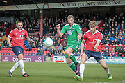 Jordan White (Wrexham AFC) and Shaun Rooney (York City) go for the ball deep inside the penalty box during the Vanarama National League match between York City and Wrexham FC at Bootham Crescent, York, England on 17 April 2017. Photo by Mark P Doherty.
