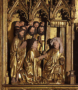 The apostles saying goodbye to the Virgin, with St John the Baptist handing her a lighted candle, from the Altarpiece of the Virgin, 1430-40, in the Eglise de Saint-Roch, Ternant, Nievre, Burgundy, France. The altarpiece was commissioned by Philippe de Ternant and his wife Isabeau de Roye, and depicts 7 scenes of the Life of the Virgin, both painted and sculpted, including the Annunciation, Dormition and Glorification. It was made by Brabant and Flemish workshops in painted and gilded carved wood. The altarpiece has been restored many times and is listed as a historic monument. Picture by Manuel Cohen