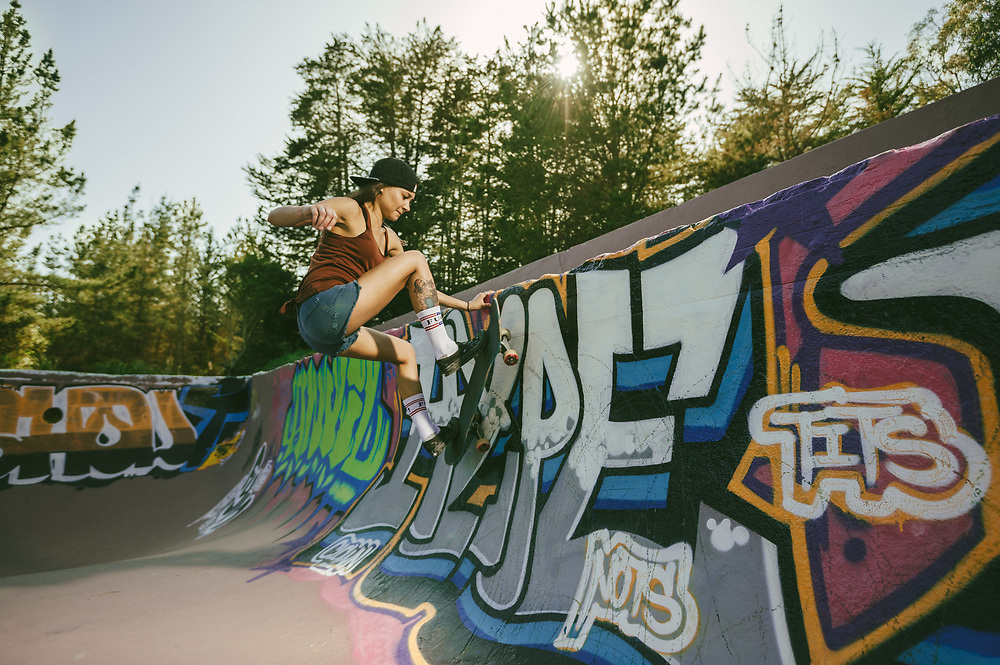 Jen Valenzuela, frontside wall ride at a classic Northern California pool.