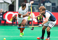 BRASSCHAAT (ANTWERP - Belgium) -  Manpreet  SINGH of India with French Martin Genestet during the Fintro Hockey World League Semi-Final match between the men of India and France (3-2) COPYRIGHT WORLDSPORTPICS KOEN SUYK