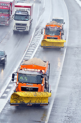 © Licensed to London News Pictures.27/02/2018<br /> ADDINGTON, UK.<br /> Two snow ploughs make their way coast bound on the M20 spreading salt.<br /> M20 snow traffic between Junction 3 and 4 Kent<br /> Photo credit: Grant Falvey/LNP