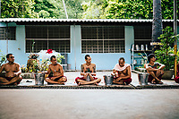 Drug addicts in the rehab program prepare for the ritual drinking and vomiting session at Tham Krabok temple in Saraburi, Thailand.