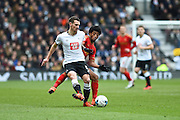 Nottingham Forest midfielder Ryan Mendes tackles Derby County midfielder Craig Bryson during the Sky Bet Championship match between Derby County and Nottingham Forest at the iPro Stadium, Derby, England on 19 March 2016. Photo by Jon Hobley.