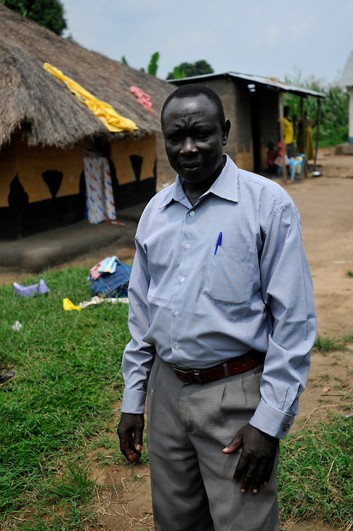Moses Gama, a 38 year old farmer at his home. The village where he lives has no potable water or public services. Clearance of landmines and UXO is being done by Mines Advisory Group (MAG) to allow for the drilling of bore holes in the community by the German NGO GIZ..Yei, South Sudan. 27/06/2011..Photo © J.B. Russell